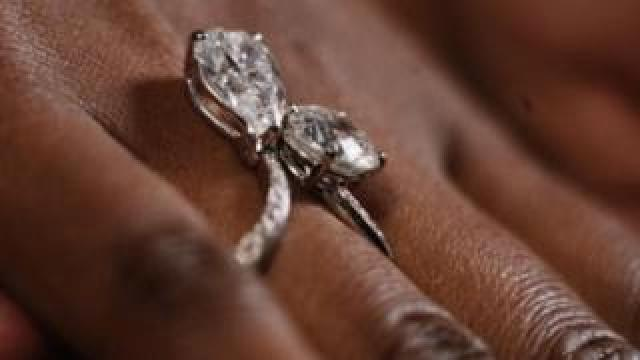 """Diamonds signed with De Beers' """"Forevermark"""" inscription"""