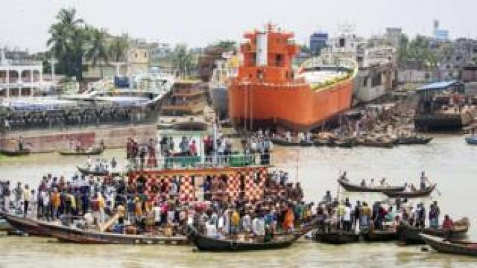 A rescue operation in the aftermath of a boat capsizing in the Buriganga river in Dhaka, Bangladesh, 29 June 2020.