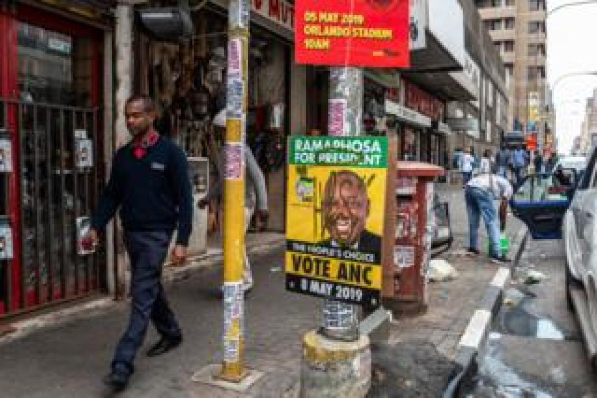 A man walks past an ANC election poster in Johannesburg