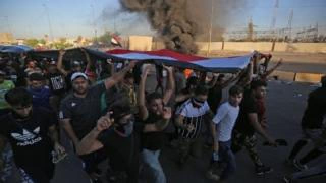 "Iraqi protesters take part in a demonstration against state corruption, failing public services, and unemployment, in the Iraqi capital Baghdad""s central Khellani Square on October 4, 2019."