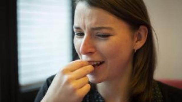 Becky eating a cricket