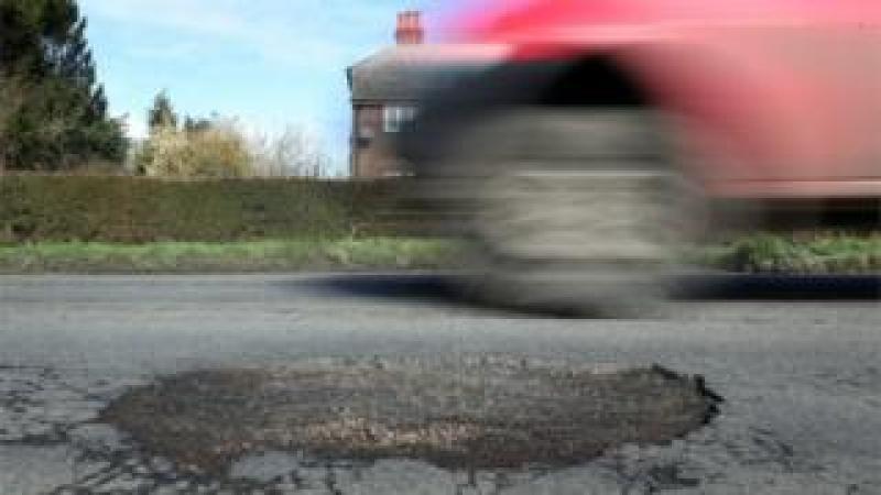 Pothole and vehicle
