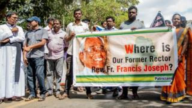 Protesters holding a banner in Killinochchi, northern Sri Lanka
