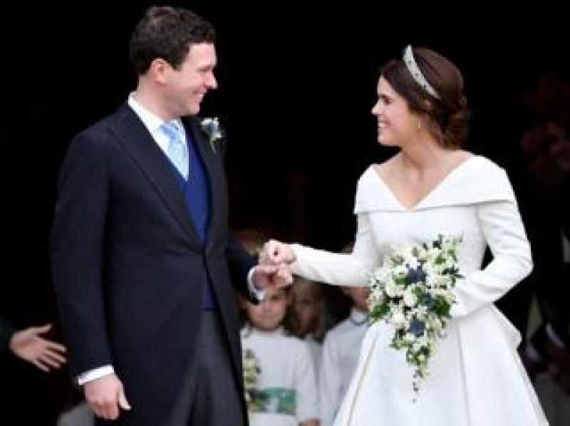 Jack Brooksbank and Princess Eugenie leave St George's Chapel