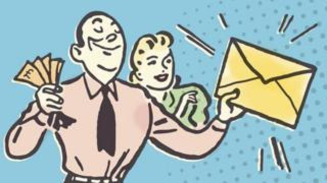 A man holding up an envelope and cash