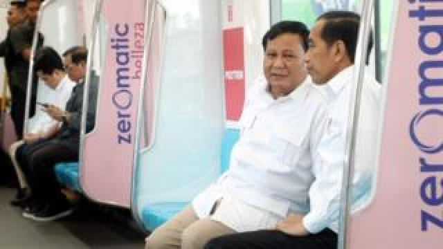 Prabowo and Widodo talk on a train