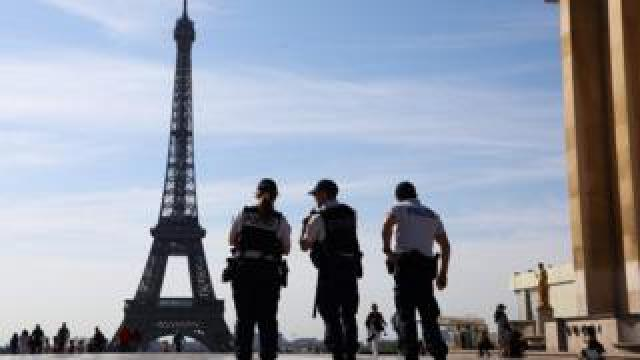 Three French policemen patrol on the Esplanade du Trocadero in front on the Eiffel Tower in Paris, on July 3, 2019.
