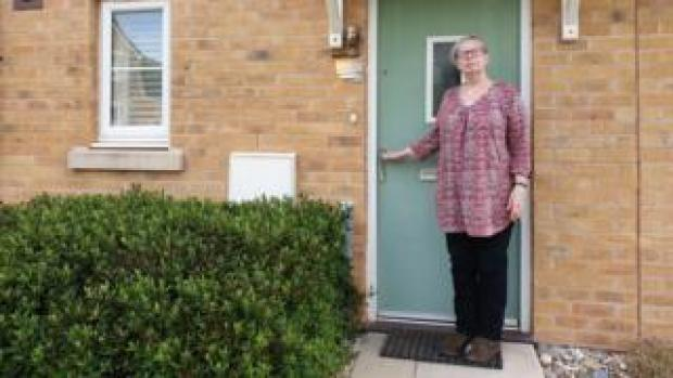 Denise Sullivan standing outside her front door