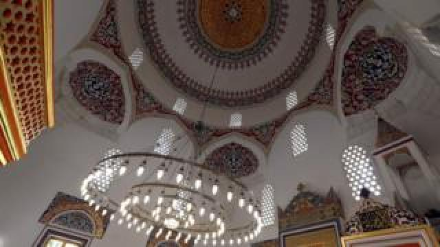 Intricate colourful artwork seen on mosque ceiling