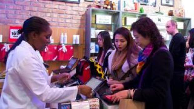 Shop worker serving customers