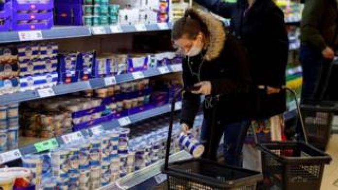 Woman shopping in London supermarket