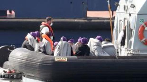 People believed to be migrants are brought to Dover on board a Border Force boat
