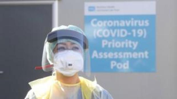 A healthcare worker wearing PPE at a hospital