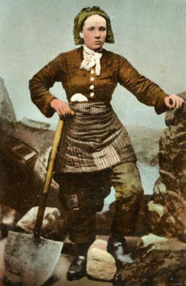 Pit brow lass shown on a postcard from the late 19th Century