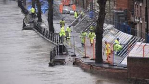 Environment Agency teams work on temporary flood barriers in Ironbridge