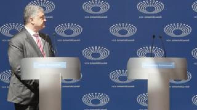 "Acting Ukrainian President and Presidential candidate Petro Poroshenko looks at the empty Volodymyr Zelensky""s podium during debate at the Olimpiyskiy Stadium in Kiev, Ukraine, 14 April 2019."