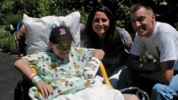 Luke Massella as a boy with his mother and uncle