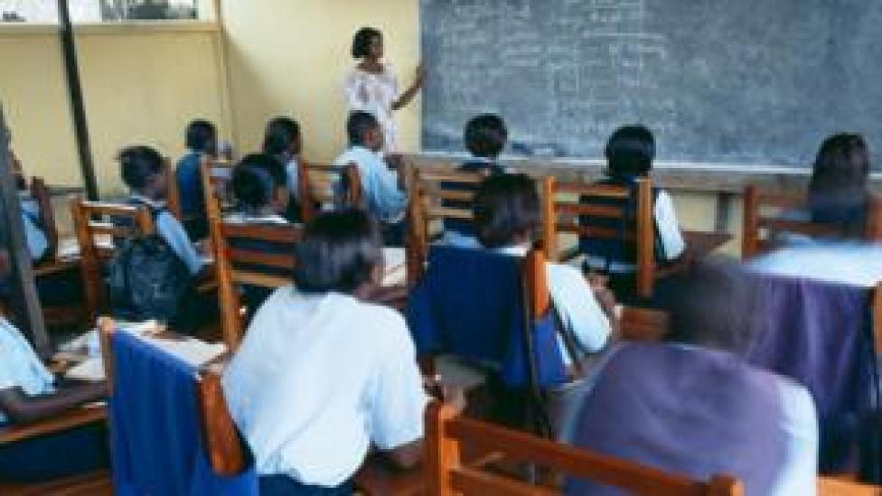 Pupils in a school classroom, learning French, in Ghana