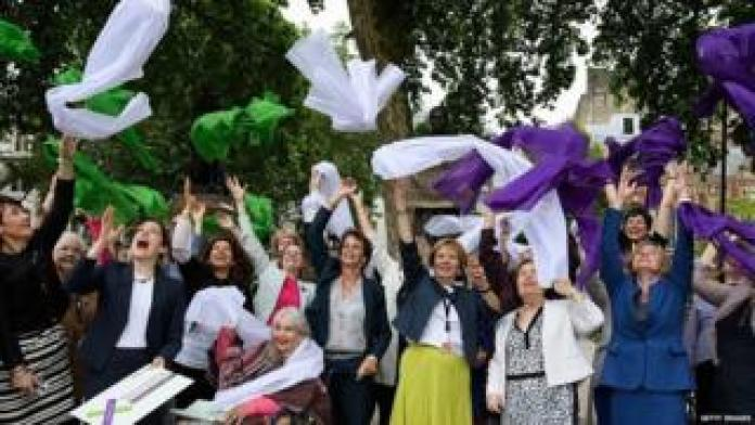 Female MPs celebrating the 100th anniversary of the 1918 Representation of the People Act