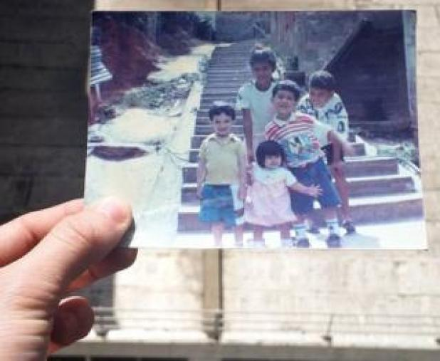 Jose holds a picture of his younger self with his cousins and a niece in Nino Jesus in the '90s