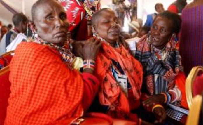 Maasai women mourn Kenya's Interior Minister Joseph Nkaissery before his burial ceremony in Ilbissil village of Kajiado county, Kenya, July 15, 2017.