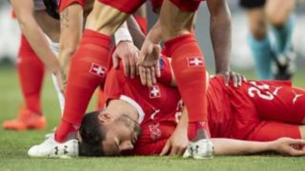 Switzerland's Fabian Schaer injured during the UEFA Euro 2020 qualifier against Georgia in Tbilisi, 23 March 2019