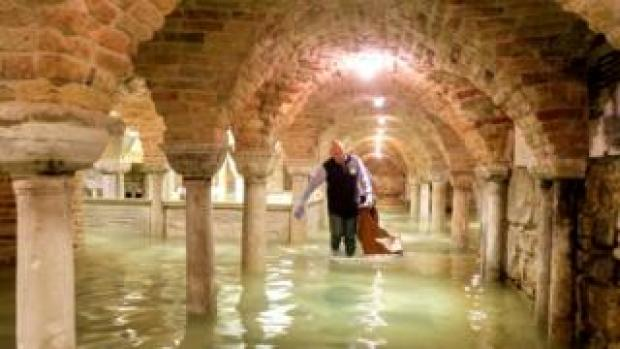 The flooded crypt of St Mark's Basilica is pictured during exceptionally high water levels in Venice, Italy, 13 November 2019