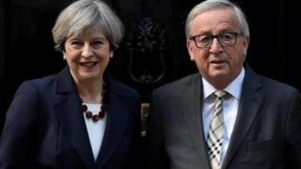 Theresa May and European Commission President Jean-Claude Juncker outside Downing Street in April 2017