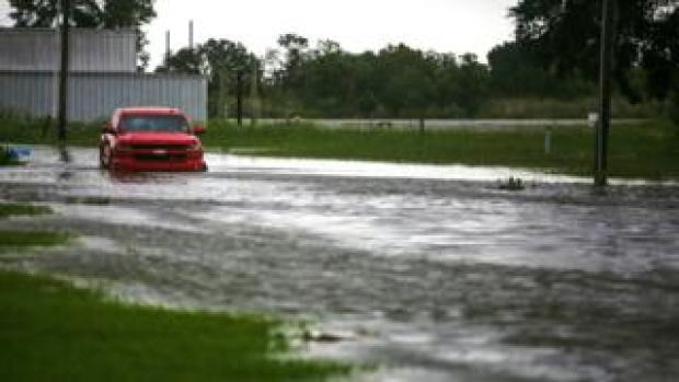 A car near Vermilion Bay is seen partially submerged in waters brought by Hurricane Laura approaching Abbeville, Louisiana, 26 August 2020