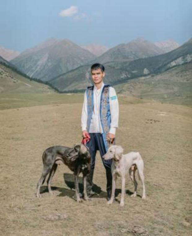 A man poses with dogs