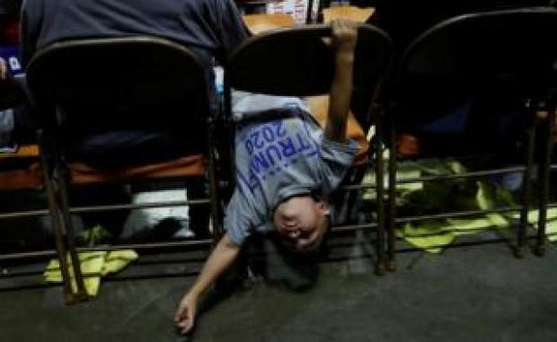 A child plays on a seat during a Make America Great Again rally.