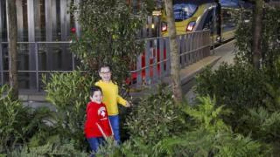 Children playing in a woodland created to mark Eurostar's 25th birthday