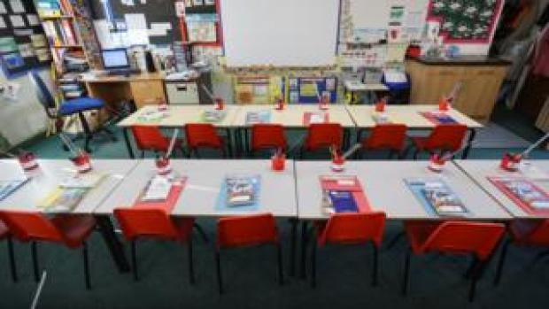 A view shows desks in a classroom prepared by Westlands Primary School's staff for the new school year, as pupils return to school tomorrow