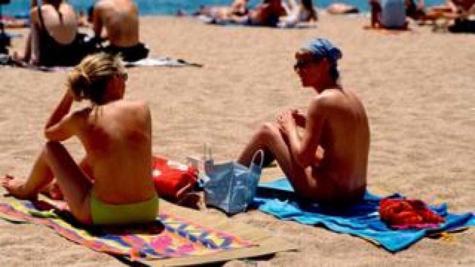 Two women sunbathing in Spain