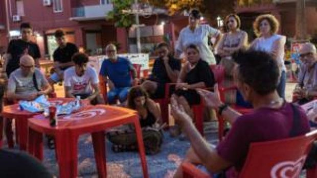 Community groups meet in the Tamburi neighbourhood of Taranto to discuss the closure of two schools