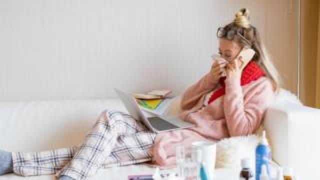 Generic picture of woman at home sick