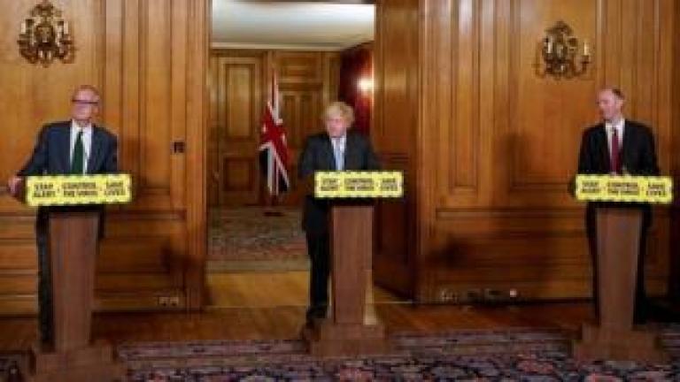 Sir Patrick Vallance, Boris Johnson and Prof Chris Whitty
