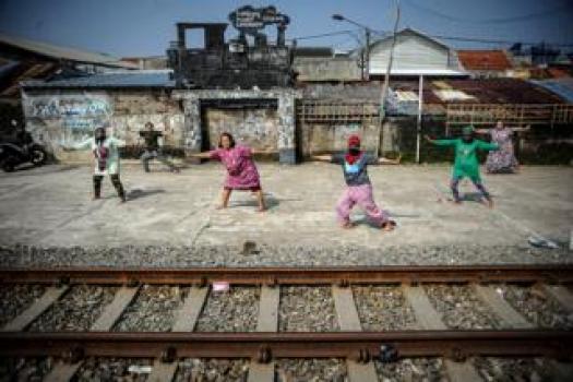 People stretch next to train tracks
