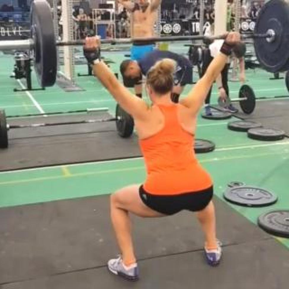 Molly Williams squatting with heavy weights