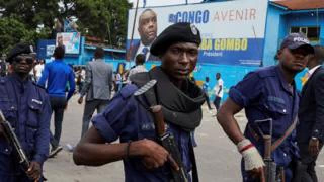 Police officers stand guard as supporters of DR Congo's defeated opposition candidate for the presidential election Martin Fayulu gather to attend a rally in Kinshasa, Democratic Republic of the Congo, 11 January 2019