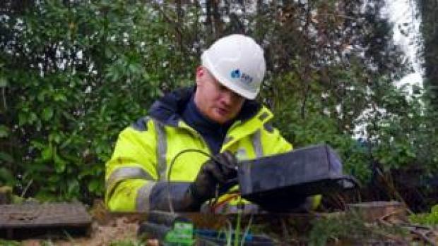 Water leak sensor being installed