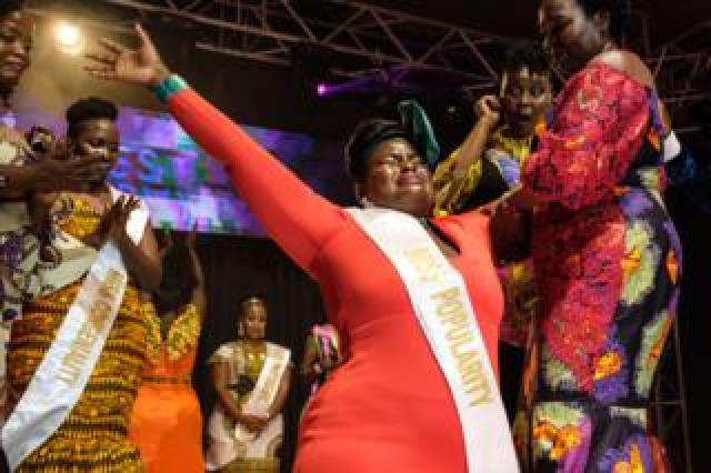Nasasi Belinda (C), a business woman, reacts with emotions as she is crowned Miss Curvy Uganda during the first edition of Miss Curvy Uganda in Kampala, Uganda, on April 26, 2019.