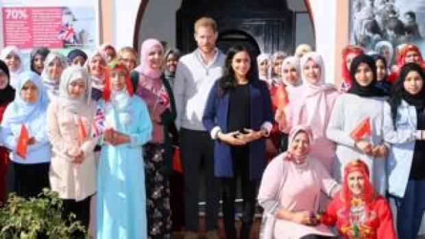 """Prince Harry and Meghan pose with staff and girls as they visit a boarding house for girls run by the Moroccan NGO """"Education for All"""" in Asni, Morocco"""