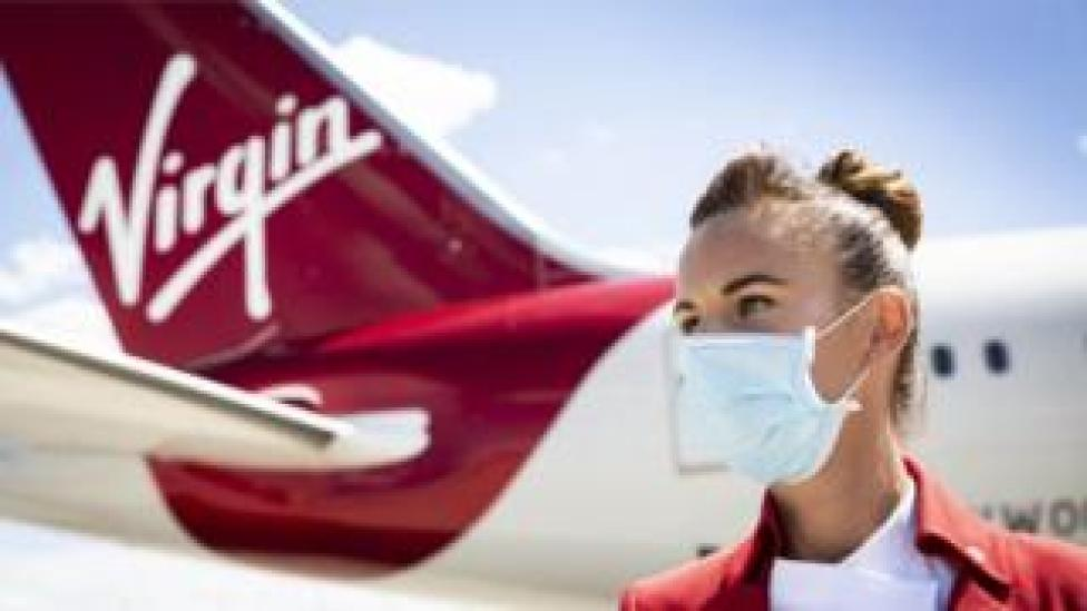 Cabin Crew Member, Natalie Burton prepares a Virgin Atlantic aircraft for the first passenger service after a three month pause due to Covid-19, London Heathrow Airport.