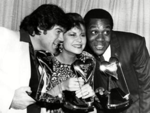 Comedians David Copperfield, Tracey Ullman and Lenny Henry with their awards for TV show 'Three of a Kind' at the Variety Club Awards in 1984