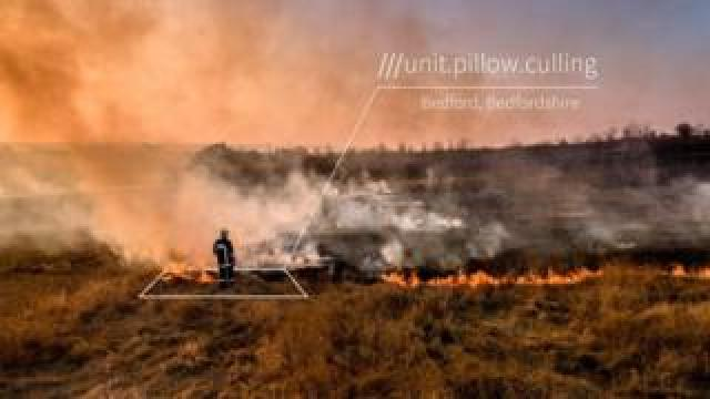 Firefighter at fire with what3words grid showing location name
