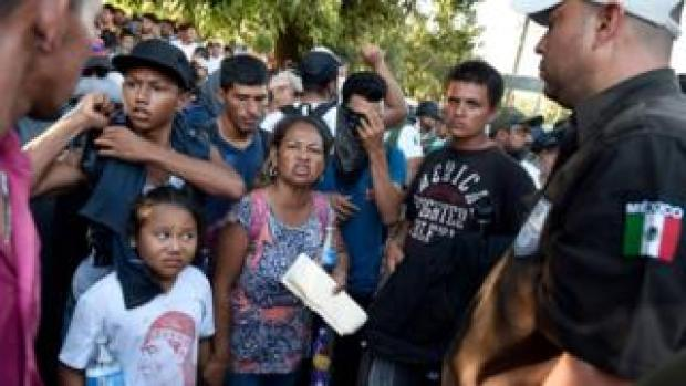 Central American asylum seekers confronted by Mexico security officials last month