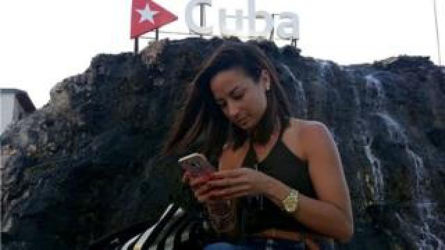 Cuban on mobile phone