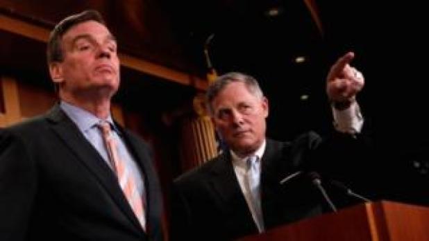 Democrat Mark Warner (L) and Republican Richard Burr