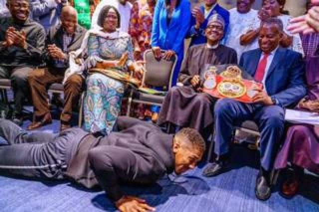 Anthony Joshua prostrating before Muhammadu Buhari
